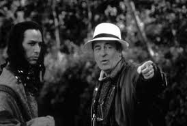 Keanu Reeves receiving direction from director Bernardo Bertolucci