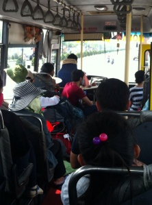 With his green hat and hand on bag, Tom stood up to the (bus) mafia!
