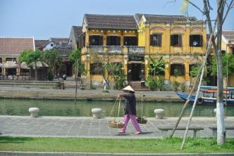 Local street urchin walking along the river