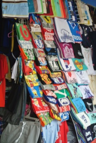 Central market Phnom Pehn: John treated himself to 4 tshirts for 1 (0) dollar (s)