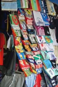 Central market Phnom Pehn: John treated himself to 4 tshirts for 1 (0) dollar (s)