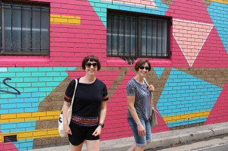 Karen and Bernadette in front of the Elysium 2481 Mural