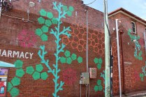 This piece highlights the Pharmacy on Fletcher Lane and Johnson Street